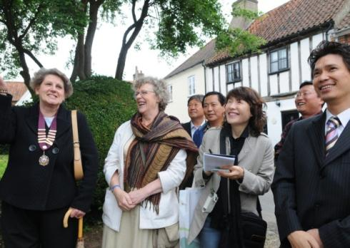 Visitors from Korea on their walk round Aylsham. On the left is Liz Jones - chairman of Aylsham Town Council and second left Susan Flack of Broadland District Council. Photo: Paul Hewitt Copy:Cromer reporters For:EDP news EDP pics © 2008 (01603) 772435
